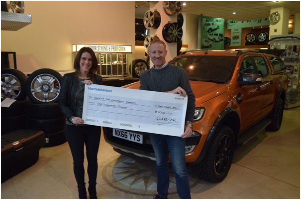 Tim Snowden MD at 4x4 Accessories & Tyres Ltd with Charlotte Farrington of Variety The Childrens Charity.