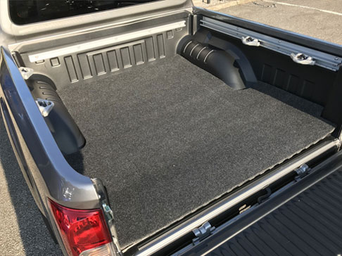 Bedmat Fitted To A Plastic Load Bed Liner Of A Pickup Truck