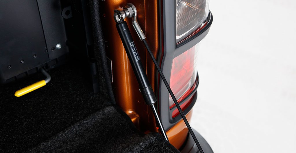 Best 4x4 Accessories - Tailgate damper kit fitted to rear of a pickup