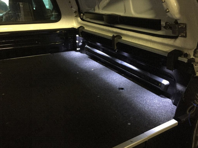 Load bed lighting in pickup truck