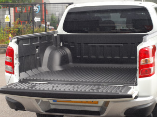 Over rail load bed liner fitted to a Mitsubishi L200