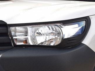 Black headlamp surround for Toyota Hilux