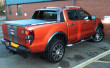 Ford Ranger Wildtrak fitted with a black leatherette soft roll truck top cover
