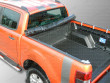 Tonneau cover uses clamps to secure the rails to the load bed
