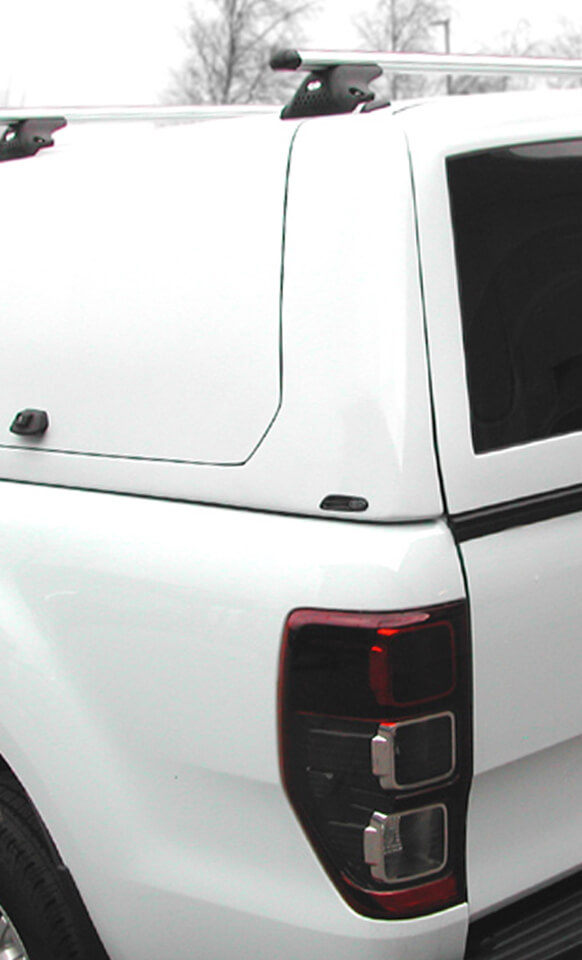 Rear view of Alpha Gullwing Truck Top canopy in white