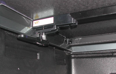 Hidden clamps on the tonneau cover for easy installation