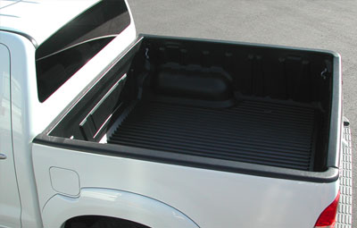 Over rail bed liner on a double cab pickup truck