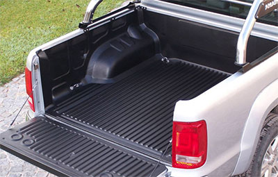 Under Rail bed liner on a double cab pickup with roll bars