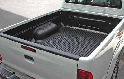 Under rail bed liner on a single cab pickup truck