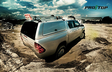 Pro//Top Low Roof Gullwing Canopy on a Toyota Hilux