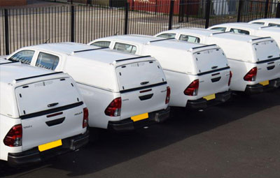 Fleet of Toyota Hiluxs fitted with Pro//Top Low Roof Tradesman Canopies