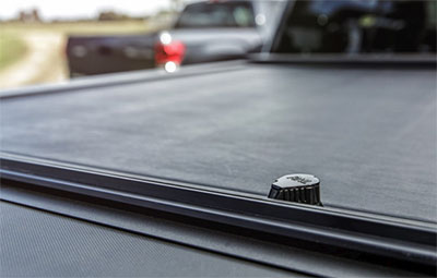 Close up of the key slot cover on the Roll-N-Lock tonneau cover