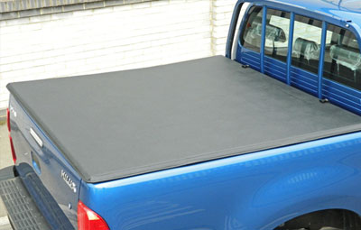 Soft tri folding load bed cover on a Toyota Hilux