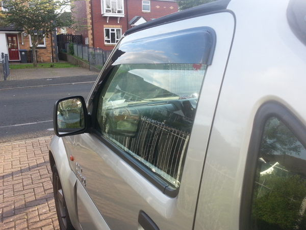 Window visors fitted on a Suzuki Jimny